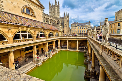Bath is a historic Roman and Georgian spa city. It is a World Heritage Site, situated 100 miles west of London and 15 miles (25 km) south-east of the nearest big city, Bristol. A unique city, Bath is famous for its hot springs, Roman period baths, Medieval heritage and stately Georgian architecture. Set in the rolling Somerset countryside on the southern edge of the Cotswolds,